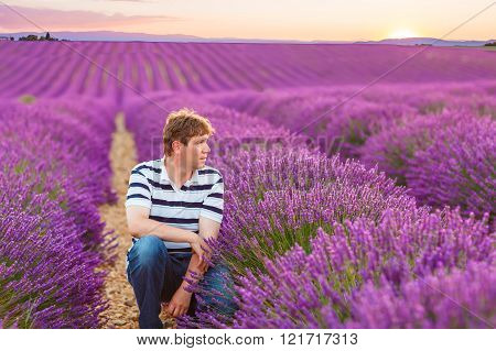 Young man in lavender fields, in Provence, France