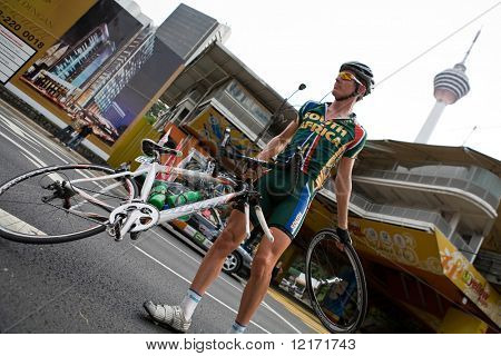 KL, MALAYSIA - 15 February: South African cyclist with a punctured wheel, at the le Tour de Langkawi race, Stage 7, KL Criterium. in Kuala Lumpur Malaysia 15 February 2009