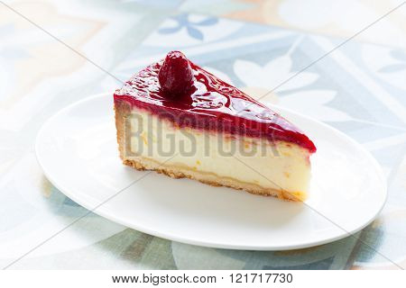 delicious , delicate cheesecake with raspberry sauce