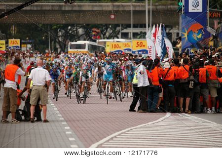 KL, MALAYSIA - 15 February: Cyclists pushing hard to the finishing line at the le Tour de Langkawi race, Stage 7, KL Criterium. in Kuala Lumpur Malaysia 15 February 2009
