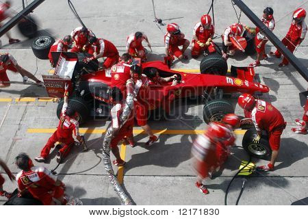 SEPANG, MALAYSIA - APRIL 4: Scuderia Ferrari Marlboro crews do pit-stop practice at the 2009 F1 Petronas Malaysian Grand Prix April 4, 2009 in Sepang Malaysia.