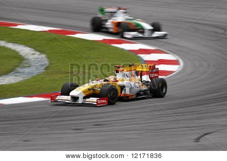 SEPANG, MALAYSIA - APRIL 4: ING Renault F1 Team Fernando Alonso in action at turn one during practice session of 2009 F1 Petronas Malaysian Grand Prix April 4, 2009 in Sepang, Malaysia.