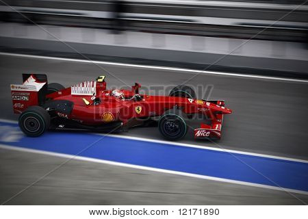 SEPANG, MALAYSIA - APRIL 4: Ferrari's Kimi Raikkonen leaving the garage at the 2009 F1 Petronas Malaysian Grand Prix. April 4, 2009 in Sepang Malaysia.
