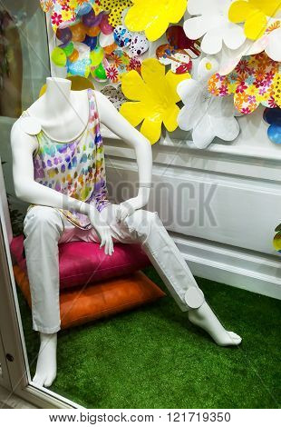 Male mannequin sitting