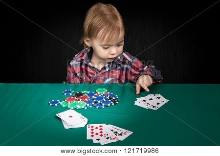 Child Playing Poker At The Table