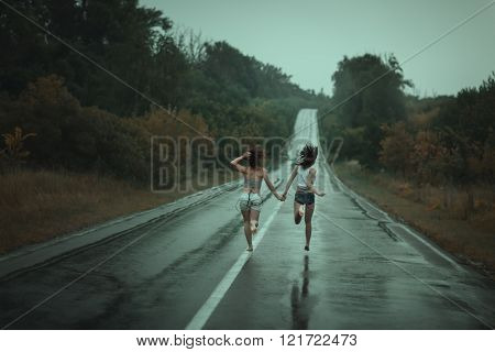 Women run on the road.