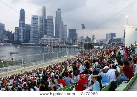 SINGAPORE - SEPTEMBER 28: Spectators at the 2008 Singtel Singapore F1 Grand Prix on September 28, 2008 in Marina Bay Circuit, Singapore.