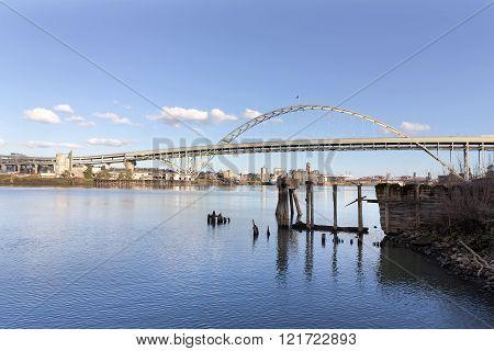 Fremont Bridge against blue sky along Willamette River in Portland Oregon