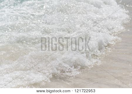 Small Wave Hitting Sandy Beach