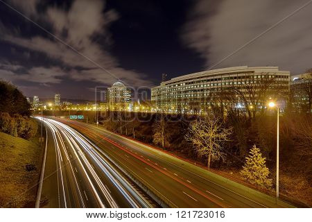 Portland Oregon Cityscape by Interstate Freeway I-84 at Night with traffic light trails