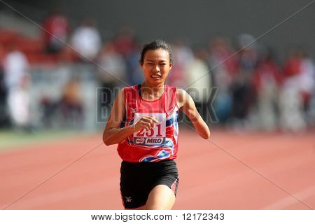 KUALA LUMPUR - AUGUST 15: Thailand's amputee athlete Jiraporn Wongsuwon runs at the track and field event of the fifth ASEAN Para Games on August 15, 2009 in Kuala Lumpur.