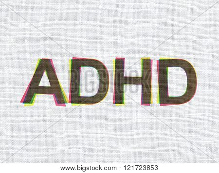 Healthcare concept: ADHD on fabric texture background