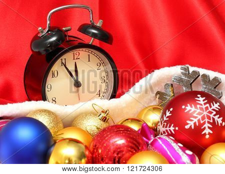 Retro clock and christmas balls and toys in a red bag