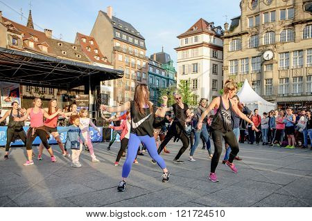 STRASBOURG FRANCE - APRIL 24 2016: Zumba public performance in the central square of the city of Strasbourg - Place Kleber