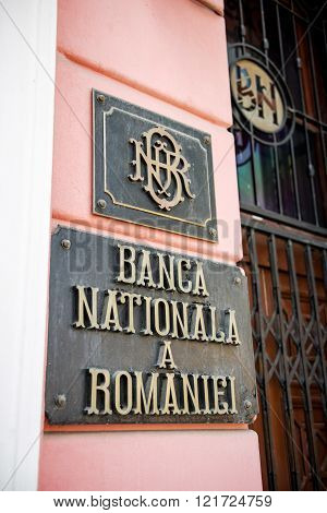 BRASOV ROMANIA - JUL 5 2015: Banca Nationala a Romaniei - National Bank of Romania steel vintage plaque at the entrance of the central branch of the bank