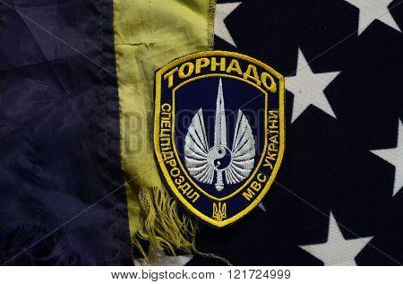 Chevron Ukrainian nazionalist battalion Tornado in Police.The battalion disbanded for looting,rape and torture February 20,2016 in Kiev, Ukraine