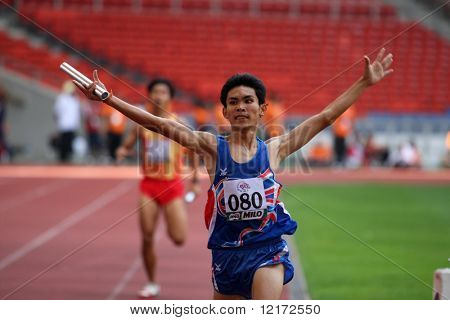 KUALA LUMPUR - AUGUST 18: Thailand's visually impaired relay team wins the 4x400m race at the track and field event of the fifth ASEAN Para Games on August 18, 2009 in Kuala Lumpur, Malaysia.