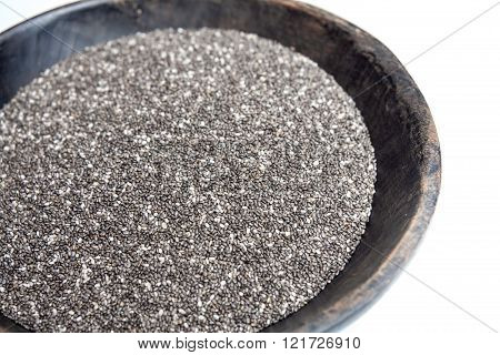 Chia Seeds In Rustic Wooden Bowl Isolated