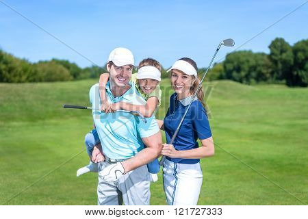 Family with child on the golf course