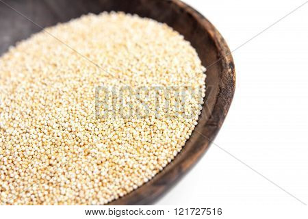 Amaranth puffed in rustic wooden bowl isolated