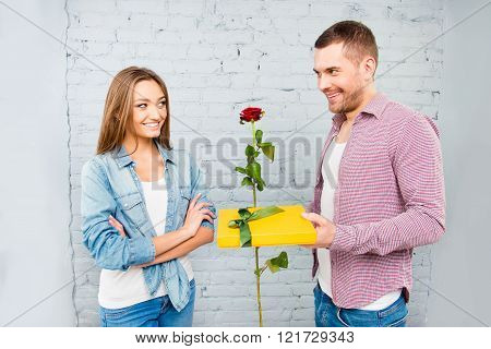 Smiling Man Congratulating His Girlfriend With Rose And Gift