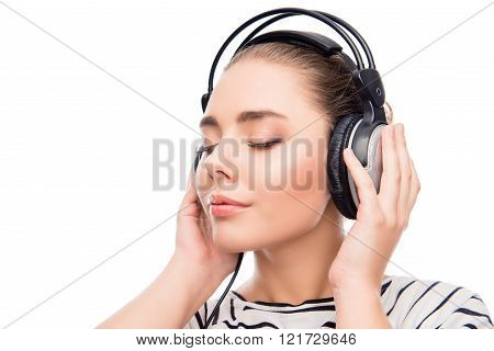 Relaxed Calm Girl Listening Music In Headphones With Closed Eyes