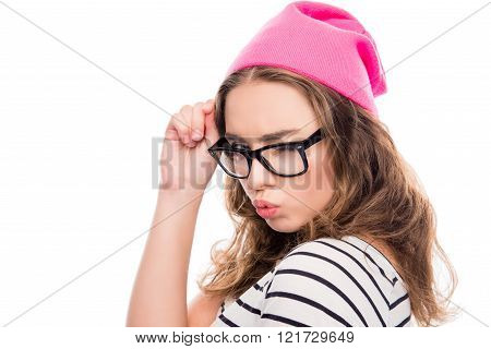 Cool Girl In Glasses And Pink Hat Pouting And Winking