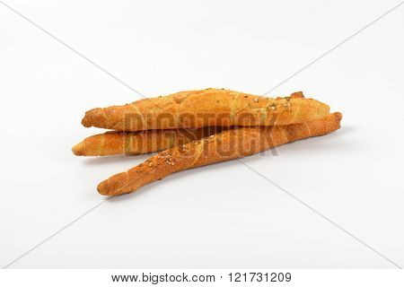 three salty long rolls on white background