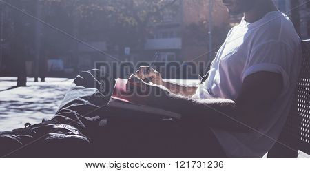 Photo man sitting student campus and texting message notepad. Studying at the University, working pr