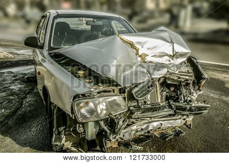 Car crash accident on a street damaged automobile after collision in city