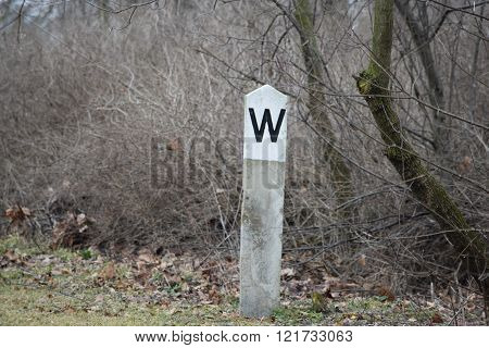 a old rail road whistle sign along a abandoned track