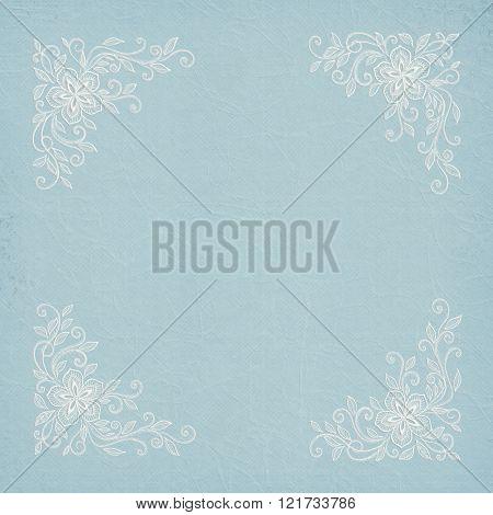 Corner lace frame on pastel aqua blue texture paper.