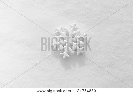 Beautiful snowflake on natural snowdrift, close up