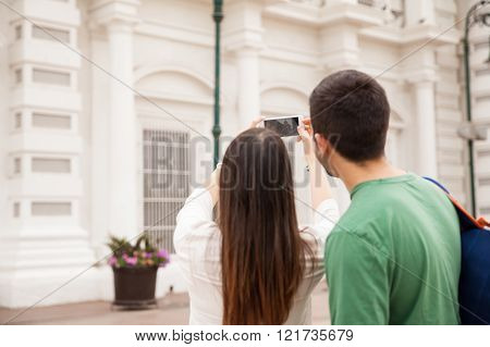 Tourists taking pictures on a trip