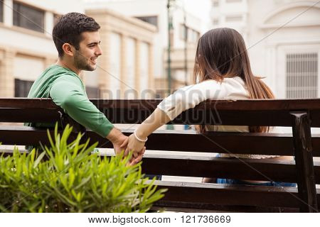 Young man holding hands with a girl