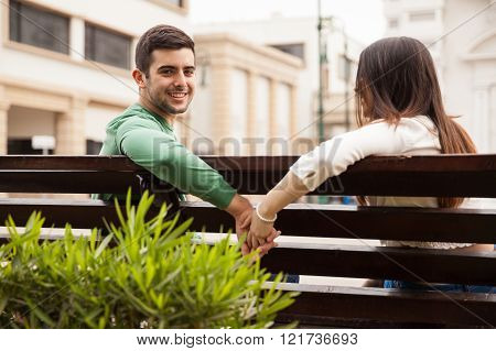 Attractive Guy And Her Date Holding Hands