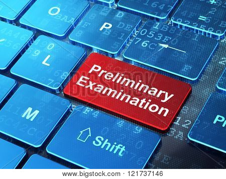 Education concept: Preliminary Examination on computer keyboard background