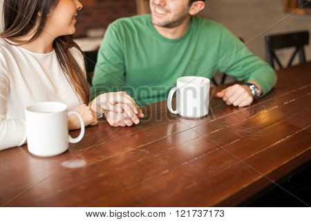 Holding Hands In A Coffee Shop
