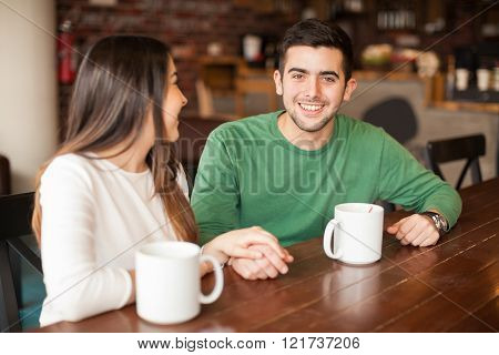 Happy couple having a cup of coffee