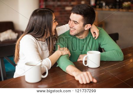 Young couple hanging out in a cafe