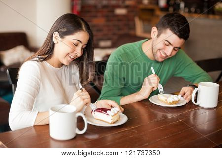 Pretty couple eating some dessert