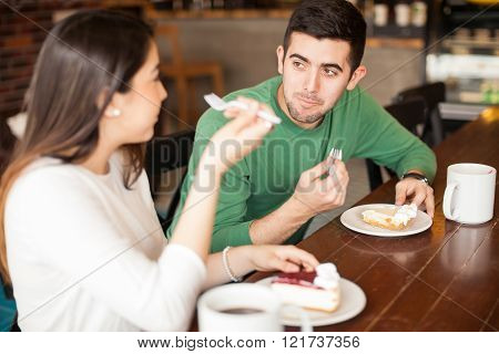 Couple enjoying pie and coffee on a date