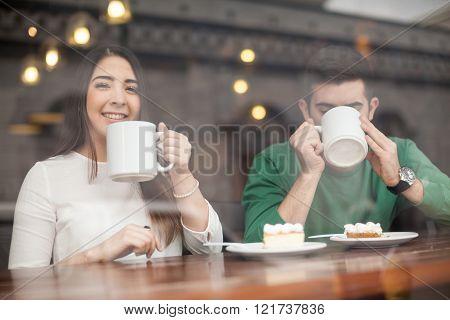 Beautiful girl drinking coffee on a date