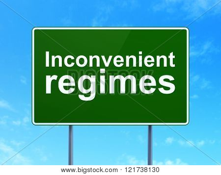 Political concept: Inconvenient Regimes on road sign background
