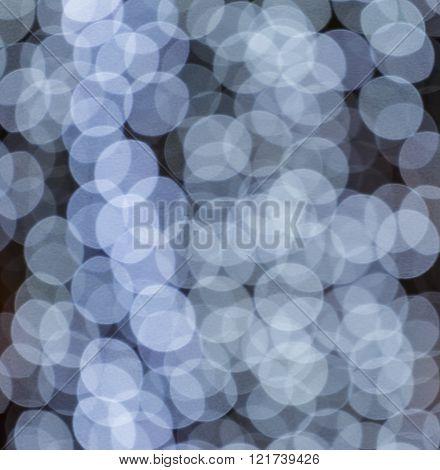 White Bokeh Lights On Black Background