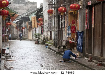 XINGPING, CHINA - MAY 20: A quiet morning before the bustling activities start in this rustic thousand year old Xingping town.  May 20, 2010 in Xingping, China.