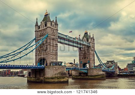 View of Tower Bridge under cloudy sky in London, UK (toned).