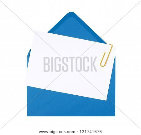 Blank birthday invitation card with blue envelope and yellow paperclip copy space