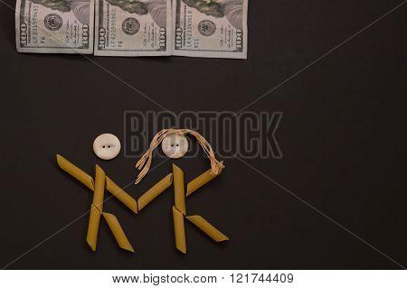 Pasta people dancing under money.  Pasta couple celebrating
