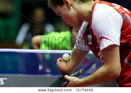 KUALA LUMPUR, MALAYSIA - SEPTEMBER 24: Paralympics Games champion Natalia Partyka of Poland serves at the Volkswagen 2010 Women's World Cup in table tennis on September 24, 2010 in Kuala Lumpur.